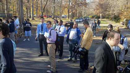 Members of the media wait outside Coach Joe Paterno's house in State College for Mr. Paterno to make a statement.
