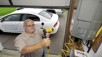 Paul Gianakas' EcoFriendly LLC installs natural gas fueling stations at homes and businesses. He has a fueling station in his own garage, which compresses natural gas from his home's service line to fuel his Honda Civic.