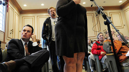 Mayor Luke Ravenstahl, left, listens as Elizabeth Beroes of Shadyside talks about 8 feet of water that flooded her basement in 2009. The community hearing on East End flooding was held Tuesday at Winchester Thurston School in Shadyside.