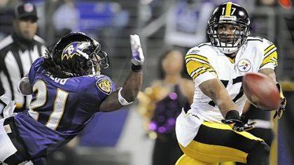 Steelers Mike Wallace stretches for a ball behind Ravens defensive back Lardarius Webb in the first Steelers-Ravens game in 2010. Wallace believes the Steelers wide receivers are too fast for Baltimore.