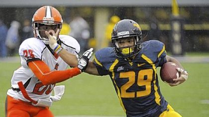 West Virginia's Dustin Garrison, right, fends off Bowling Green's Aaron Foster. Garrison finished the Mountaineers' 55-10 victory in Morgantown, W.Va., with 291 yards rushing.