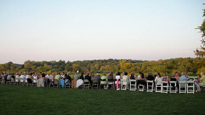 Guests enjoy an Italian dinner outdoors at a 50-foot-long table.
