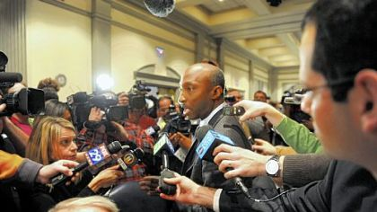 Kenneth Frazier, a Penn State trustee since 2009, speaks to the media after a board of trustees meeting at the Nittany Lion Inn on Friday.