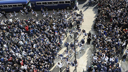 Penn State fans greet their team as they enter Beaver Stadium before the start of the game against Nebraska today.