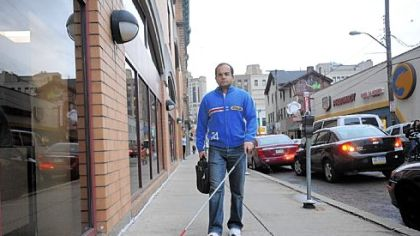 Abbas &quot;Bobby&quot; Quamar, 37, walks through Oakland. He came to the United States after the 1996 accident that blinded him because of the increased study and career opportunities here.