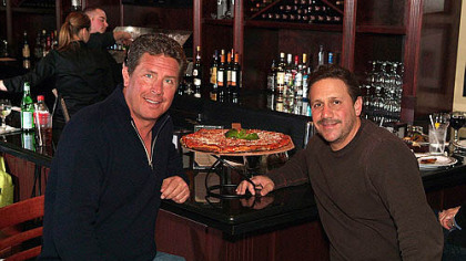 Dan Marino, left, and Anthony Bruno of Anthony's Coal Fired Pizza. Mr. Marino is one of the equity partners in a Florida-based restaurant group, which is set to open its first Pittsburgh-area location in Robinson on Saturday.