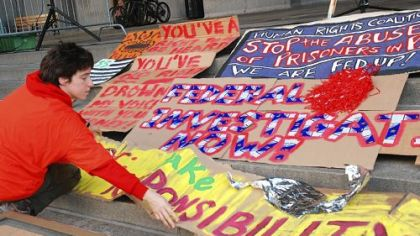 Rachel Beck of Squirrel Hill lays out protest signs on the steps of the City-County Building Tuesday in preparatioin for a rally to protest the conditions in Pennsylvania prisons following the SCI Pittsburgh indictment.