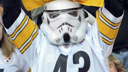 A Steelers fan cheers on his team as they take the field against the Patriots Sunday.