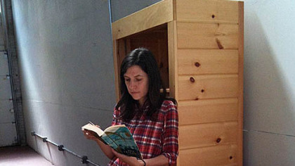 Lesley Rains is the creator of the East End Book Exchange, a pop-up bookstore. Here, she samples products while displaying at the Pittsburgh Public Market on Sunday.