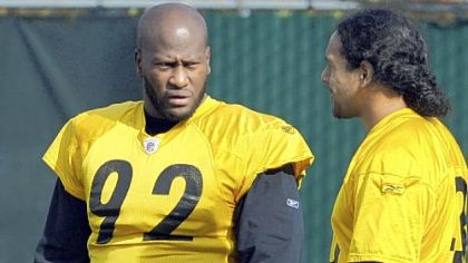 Linebacker James Harrison, talking with Troy Polamalu, right, returned to practice Wednesday for the first time since breaking the orbital bone around his right eye Oct. 2. The question: Will he/can he play Sunday?