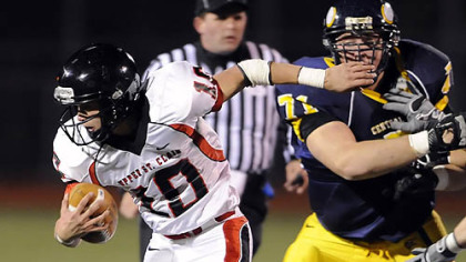 Upper St. Clair quarterback Pete Coughlin carries Friday against Central Catholic. Coughlin started the game in place of an injured Dakota Conwell.