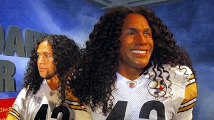 "Troy Polamalu, left, poses next to ""Legendaryous Troy,"" his wax likeness, unveiled Tuesday at Madame Tussauds in New York. The wax figure required twice the amount of hair of any other creation in the history of the famed attraction, the wax museum said in a statement."
