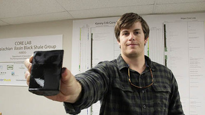 Dan Kohl, 23, a master's student in Penn State's Department of Geosciences, holds a shale core. He has a job lined up after he graduates working in Marcellus Shale for Chevron.