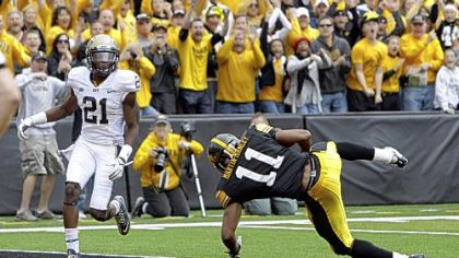 Iowa wide receiver Kevonte Martin-Manley (11) tumbles into the end zone with a 22-yard touchdown catch in front of defensive back Buddy Jackson in the fourth quarter. The touchdown was part of a 21-point comeback by the Hawkeyes.