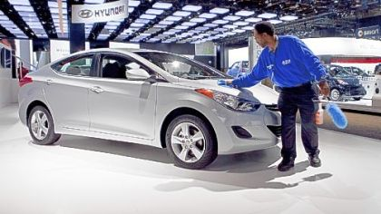 Charles Lee wipes down a Hyundai Elantra during the North American International Auto Show in Detroit in January. Through August, Elantra's sales were up 46.8 percent, according to Automotive News.