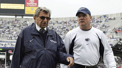 Penn State interim football coach Tom Bradley, right, walks with former Coach Joe Paterno in this 2009 photo.