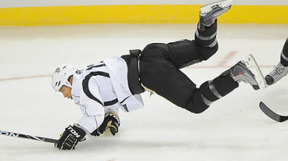 Richard Park is upended during drills the first day of camp at the Consol Energy Center. Park is back with the Penguns for the first time since 1997, when he left in a trade.