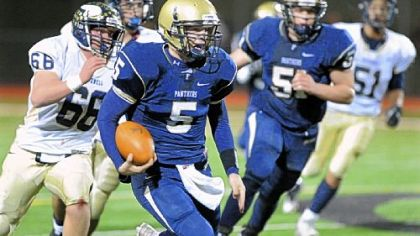 Franklin Regional quarterback Nico LoDovico runs for extra yardage against Hopewell in the second quarter.