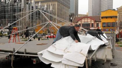 The tarp is pulled into place Thursday for the stage at Market Square for Light Up Night. Entertainment in the square begins at 5 p.m. Friday. Events at other Downtown venues also start at dusk, culminating with fireworks over the Clemente Bridge at 9:38 p.m. Noontime events for the holiday season will take place at the City-County Building and at U.S. Steel Tower Plaza.