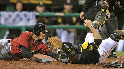 Catcher Ryan Doumit tags out the Astros' Jimmy Paredes at the plate to help the Pirates get out of the eighth inning.