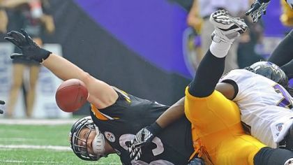 "Tight end Heath Miller loses control of a pass from Ben Roethlisberger in the Steelers' 35-7 loss Sunday against the Baltimore Ravens. ""There'd be something wrong if we don't expect more from ourselves,"" Miller said."