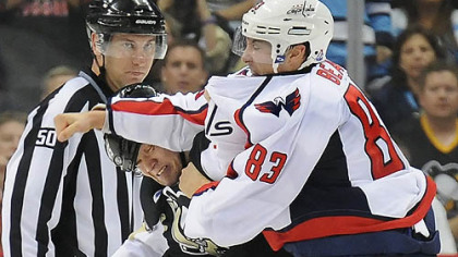 The Penguins' Arron Asham fights the Capitals' Jay Beagle in the third period Thursday. Asham apologized for his antics after knocking Beagle to the ice.