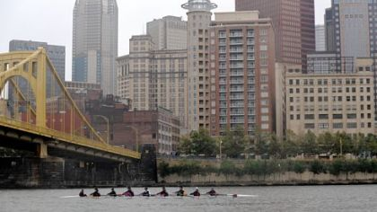 Rowers cruise along the Allegheny River during Saturday's 25th anniversary Head of the Ohio rowing regatta, which updated its course for this year's race.