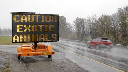 Motorists driving I-70 near Zanesville, Ohio, Wednesday encountered this warning of exotic animals on the loose.
