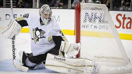 Penguins goalie Marc-Andre Fleury makes a save during the second period.