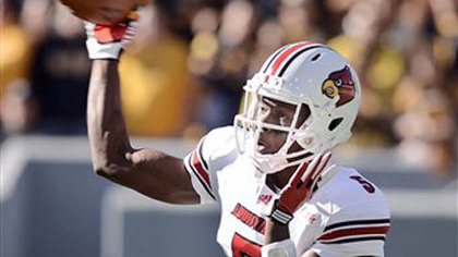 Louisville quarterback Teddy Bridgewater throws a pass against West Virginia during the first quarter of Saturday's game in Morgantown.