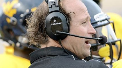 Dana Holgorsen got the victory against Marshall Sunday in his debut at West Virginia. But the coach showed some frustration in the second half.