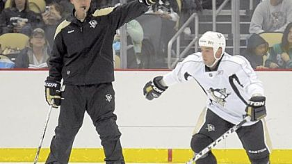 Dan Bylsma, left, sends Steve Sullivan off on a drill at Penguins training camp Sept. 18 at Consol Energy Center.