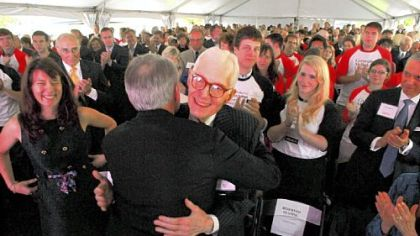 William S. Dietrich II, center, is greeted by Raymond Lane, chairman of Carnegie Mellon University&#039;s board of trustees, as his daughter, Anna Elizabeth Diemer, of San Francisco, smiles at left.
