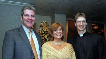 Joe Garrity, Kendra McLaughlin and the Rev. Father Michael Stumpf.