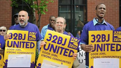 Members of SEIU Local 32BJ Luis Barrero, Gigi Tierno and William Gerner march during a rally to create and preserve family-sustaining jobs at the South Side Works, Monday afternoon, Sept. 26.