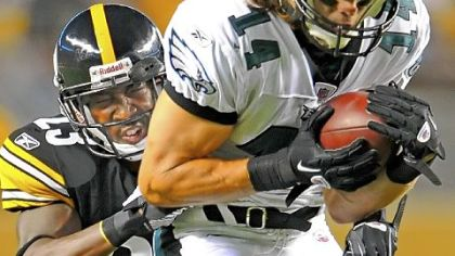 "Cornerback Keenan Lewis wraps up the Philadelphia Eagles' Riley Cooper in preseason action in August. ""The older you get, you have to grow at this position,"" said Lewis, who has eight solo tackles so far this season."