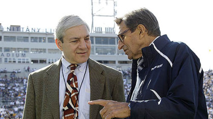 Penn State President Graham Spanier, left, talks with Coach Joe Paterno before a football game against Iowa in October in Beaver Stadium.