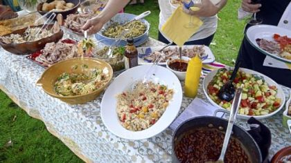 Spread of food at Gretchen McKay's pig roast.
