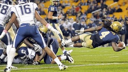 Pitt's Zach Brown dives into the end zone for a touchdown against Connecticut at Heinz Field.
