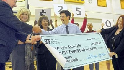 Pittsburgh Brashear High School physics teacher Steve Scoville gets congratulations as he receives a Milken Educator Award in a surprise ceremony Tuesday at the school. The award comes with a $25,000 prize. He's one of 40 educators nationwide receiving the honor. At left is retired Langley High School teacher Ed Henke, who won the award in 1997.