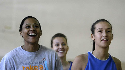 Marion Jones, left, participates in a basketball clinic at a high school in Belgrade, Serbia, earlier this month as part of a U.S. State Department program, presenting lectures and basketball clinics to young adults.