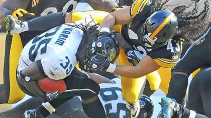 Troy Polamalu tackles Jaguars running back Deji Karim for a loss in the second quarter Sunday at Heinz Field.