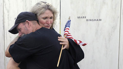 Alice Hoagland, mother of Mark Bingham, who died on Flight 93, hugs Iraqi war veteran Glenn Crutchfield of Coal Hill, Ark. The Wall of Names has the names engraved of the 40 victims of the Flight 93 crash.