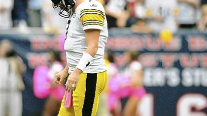 Ben Roethlisberger walks off the field slowly after being sacked by Houston for the fifth time.