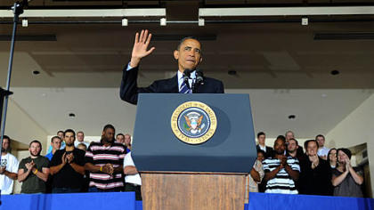 President Obama acknowledges the audience at the IBEW training center on the South Side as he speaks about his jobs bill.