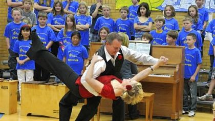 Howe Elementary School teachers Jason Kukic and Caylin Charrie do a tango for students. The dance was part of an assembly welcoming two students and their teacher from Uruguay; they will be spending two weeks in Pittsburgh.  Live video from the assembly was streamed back to the school in Uruguay.