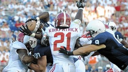Silas Redd stretches through two Alabama defenders to score the Nittany Lions' only touchdown.
