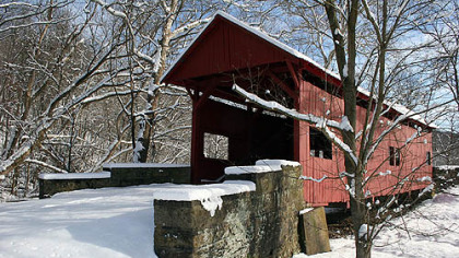 The Hughes Covered Bridge in snow in 2009. The bridge now is used only for foot traffic. It stands just to the east of I-79 near the Marianna/Prosperity exit.