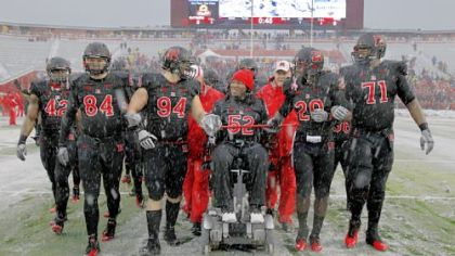 EMOTIONAL KNIGHT Former Rutgers player Eric LeGrand (52), paralyzed in a game against Army last season, led the Scarlet Knights onto the field at Rutgers before a  game Saturday against West Virginia.