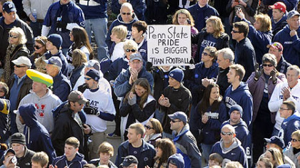 Fans line up outside Beaver Stadium to see their team enter the stadium before the start of their team's game against Nebraska today. One sign commented on the sex abuse reporting scandal that rocked the university this week and ended the coaching career of the legendary Joe Paterno.